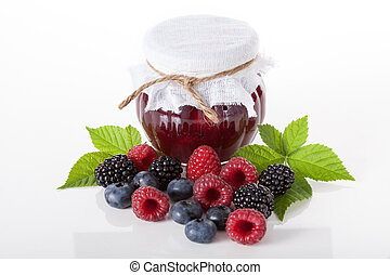 Berry jam, isolated background - Fresh berries and jam on...