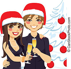 Couple Christmas Toast - Young couple hugging and making a...