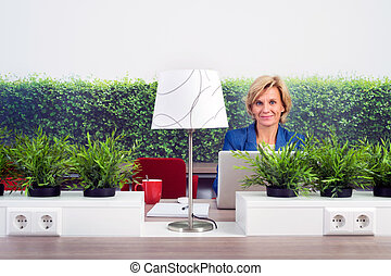 Confident Female Environmentalist In Office - Portrait of...
