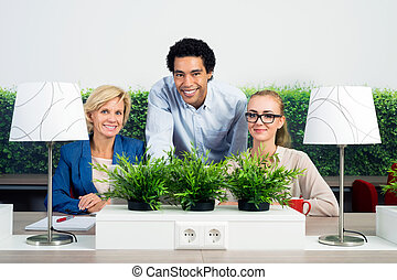 Portrait Of Confident Environmentalists In Office - Portrait...