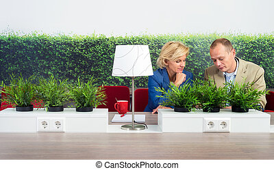 Environmentalists Working At Desk In Office - Male and...