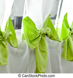 Wedding party chairs decoration in white and green