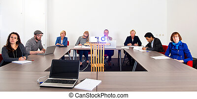 Meeting - Group of colleagues attending a presentation in a...