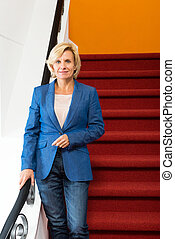 Confident Businesswoman Standing On Steps - Portrait of...