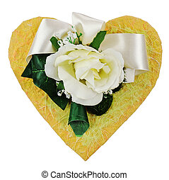 Composition of artificial flowers in heart shape isolated on white background.