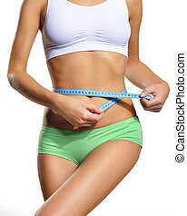 Girl with blue tape measure waist circumference