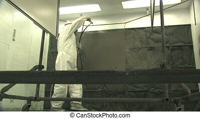 Industrial Spray Painting, Low Angl - Low angle of a man in...