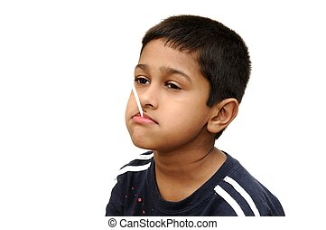 Lollypop - an handsome Indian kid having dun savoring a...
