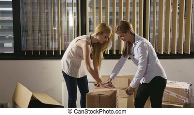 team of business women moving offic - team of female...