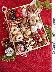 Little box with a variety of cookies and nuts