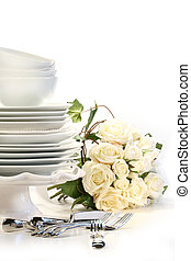 Assortment of plates for wedding on white background