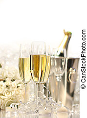 Glasses of champagne for a wedding reception on white...