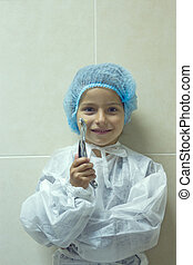 child playing in doctor dentist