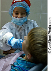 couple of kids playing doctor at the dentist - A couple of...