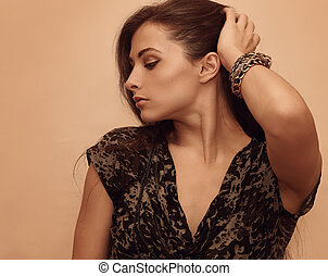 Sexy fashion woman with modern bangle on the hand
