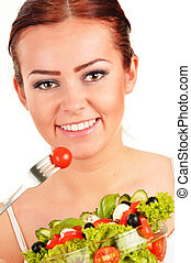 Young woman eating vegetable salad