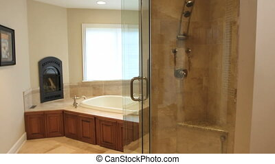 Luxury Home Bathroom - Moving dolly shot of a master...