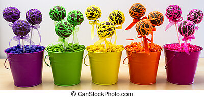 Swirl Cake Pops - Line of rainbow colored chocolate cake...