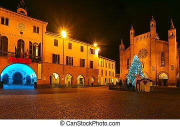 Christmas tree on central square. Alba, Italy. - Illuminated...