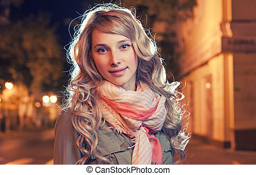 Portrait of a young female businesswoman in night city....