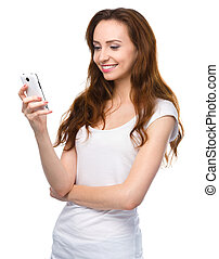 Young woman is typing sms message on her phone - Young...