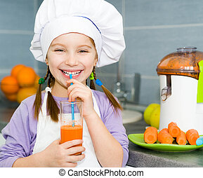 girl making fresh juice - smily girl drink a fresh carrot...