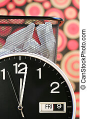 Clock showing time with waste paper basket and retro...