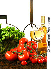Fresh tomatoes, lettuce and wine