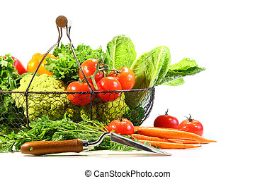Summer vegetables with garden shovel on white background