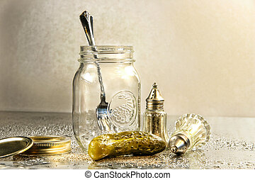Pickle with a jar and antique salt and pepper shakers