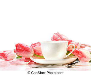 Tea cup with pink tulips on white background