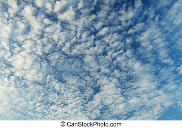 Altocumulus clouds - natural beauty contrast background -...
