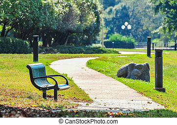 bench in a park with a walkway