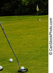 Golf ball on a green, in front of the hole,