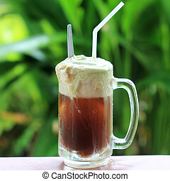 Root beer float, a tasty summer treaton Green tree...