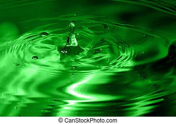 green multi colored water drop bubbling - multi colored...