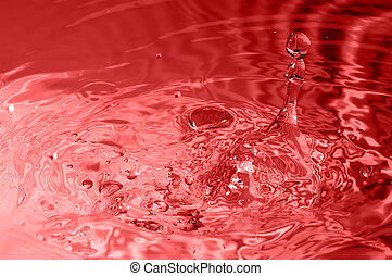red multi colored water drop bubbling - multi colored water...