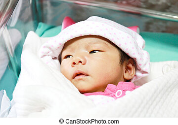 Newborn asian baby girl in hospital