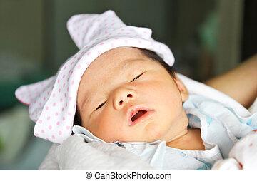 Newborn Asian baby girl sleeping