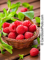 Fresh raspberries and mint in a basket