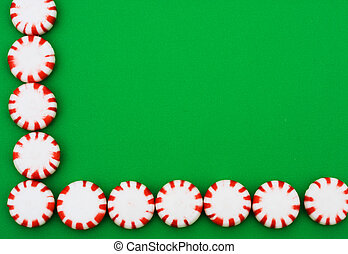 Peppermint Border - Red and white peppermints sitting on a...