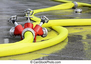 Firehose connected to a distribution device with faucet