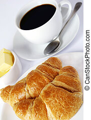 coffee and croissants - continental breakfast of coffee and...