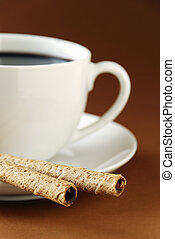 black coffee and wafers - a cup of black coffee and...