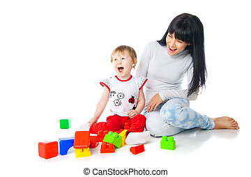 mother and baby playing with building blocks toy