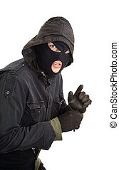 Burglar - Robber in a black mask sneaking inside