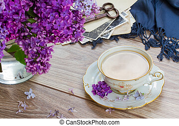 summer tea time - cup of tea with lilac and vintage photos