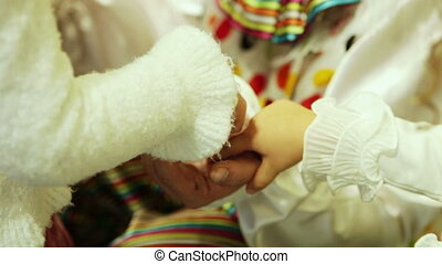Childrens hands - Children play with a clown