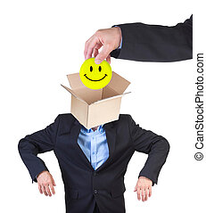 Office happiness - Hand putting smiley into mans head...