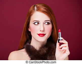 Woman in luxury fur scarf with lipstick